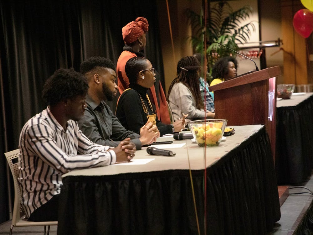 "Panelists are seated at University Program Board's ""Surviving a Predominately White World"" event Feb. 5, 2020, in Cardinal Hall at the L.A. Pittenger Student Center. The Q-and-A style event focused on issues faced by people of color in a predominantly white university and world. Rohith Rao, DN"