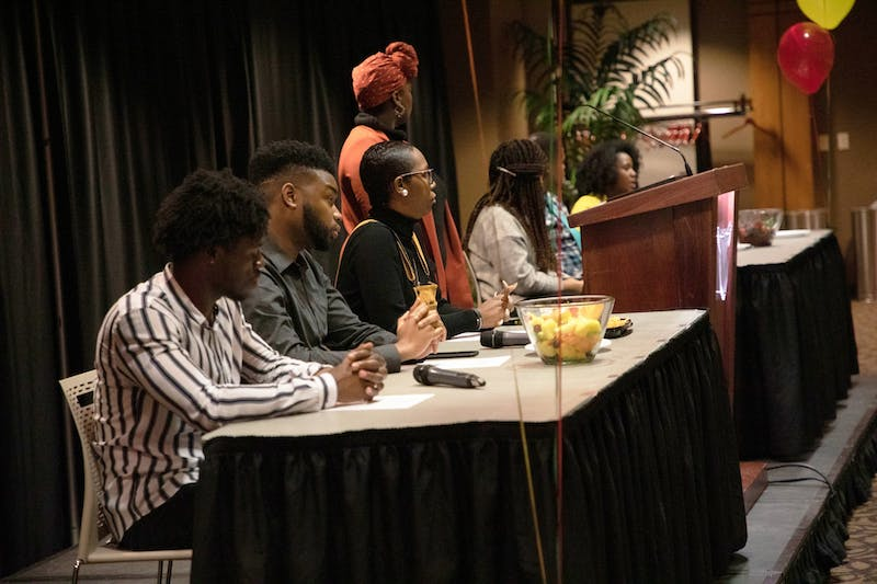 """Panelists are seated at University Program Board's """"Surviving a Predominately White World"""" event Feb. 5, 2020, in Cardinal Hall at the L.A. Pittenger Student Center. The Q-and-A style event focused on issues faced by people of color in a predominantly white university and world. Rohith Rao, DN"""