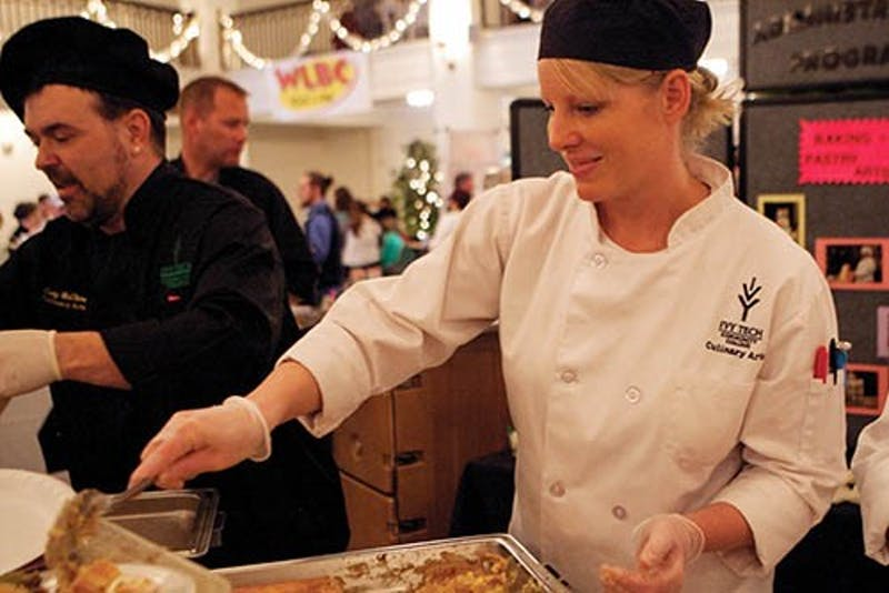 Ivy Tech student Alisha Mosier serves a dish made by students during the annual Taste of Muncie on April 21, 2013. Twenty-two organizations had booths with food for tasting at the Cornerstone Center of the Arts building downtown. Jordan Huffer, DN File
