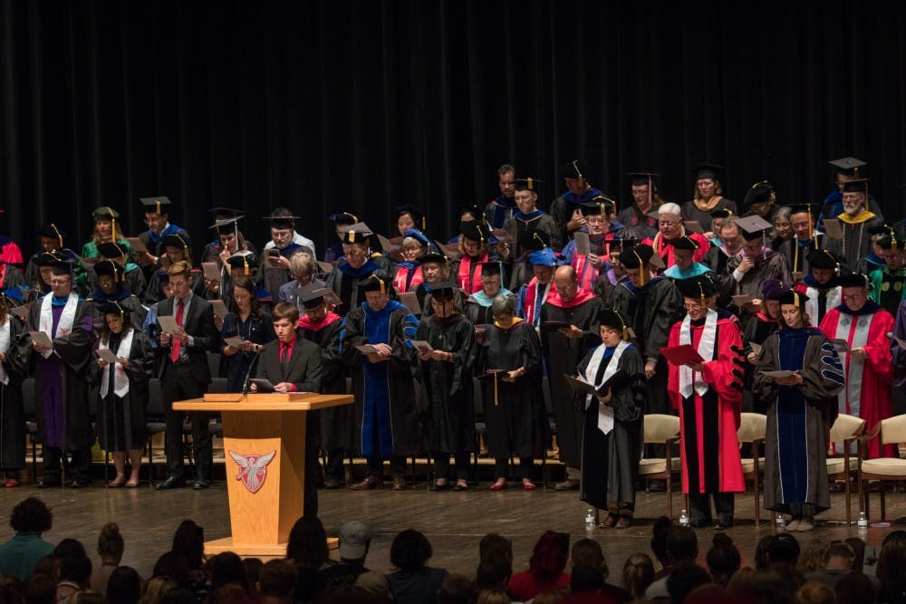 <p>Isaan Mitchell, President of Student Government Association, leads Emens Auditorium in the Beneficence Pledge during the freshmen convocation Sunday, Aug. 19. <strong>Eric Pritchett, DN</strong></p>