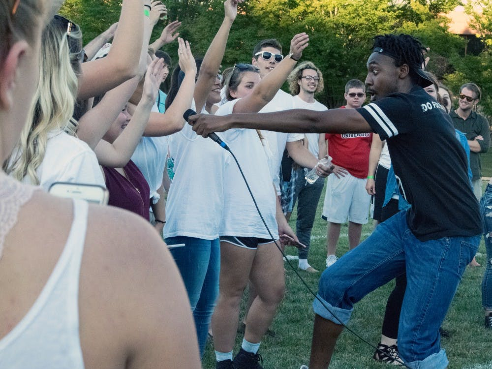 Rapper LJ III encourages his audience to chant some of his lyrics during Bonnamu on Sept. 15 at LaFollette Field. The winner of the battle wond a free recording session. Rachel Ellis, DN
