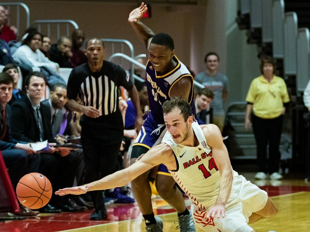 Senior forward Kyle mallers dives for a ball Nov. 26, 2019, at John E. Worthen Arena. Mallers had 12 points against Western Illinois. Jacob Musselman, DN