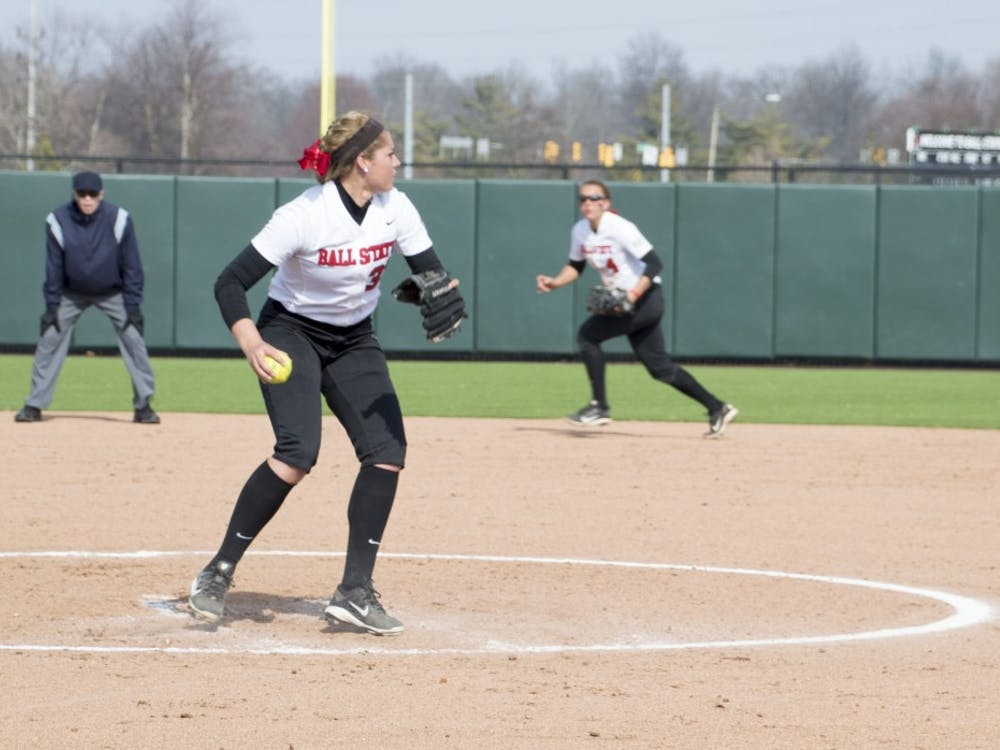 Freshman pitcher Carolyn Wilmes throws the ball to first base during the second game of the double header against Western Kentucky at First Merchants Ballpark Complex on March 21. DN PHOTO ALAINA JAYE HALSEY