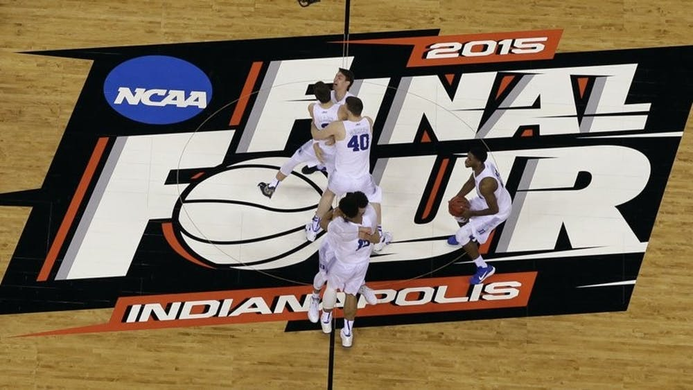 <p>FILE - Duke players celebrate after the NCAA Final Four college basketball tournament game against Wisconsin in Indianapolis, in this Monday, April 6, 2015, file photo. The NCAA announced Monday, Nov. 16, 2020, it plans to hold the entire 2021 men&#x27;s college basketball tournament in one geographic location to mitigate the risks of COVID-19 and is in talks with Indianapolis to be the host city (AP Photo/David J. Phillip, File) </p>