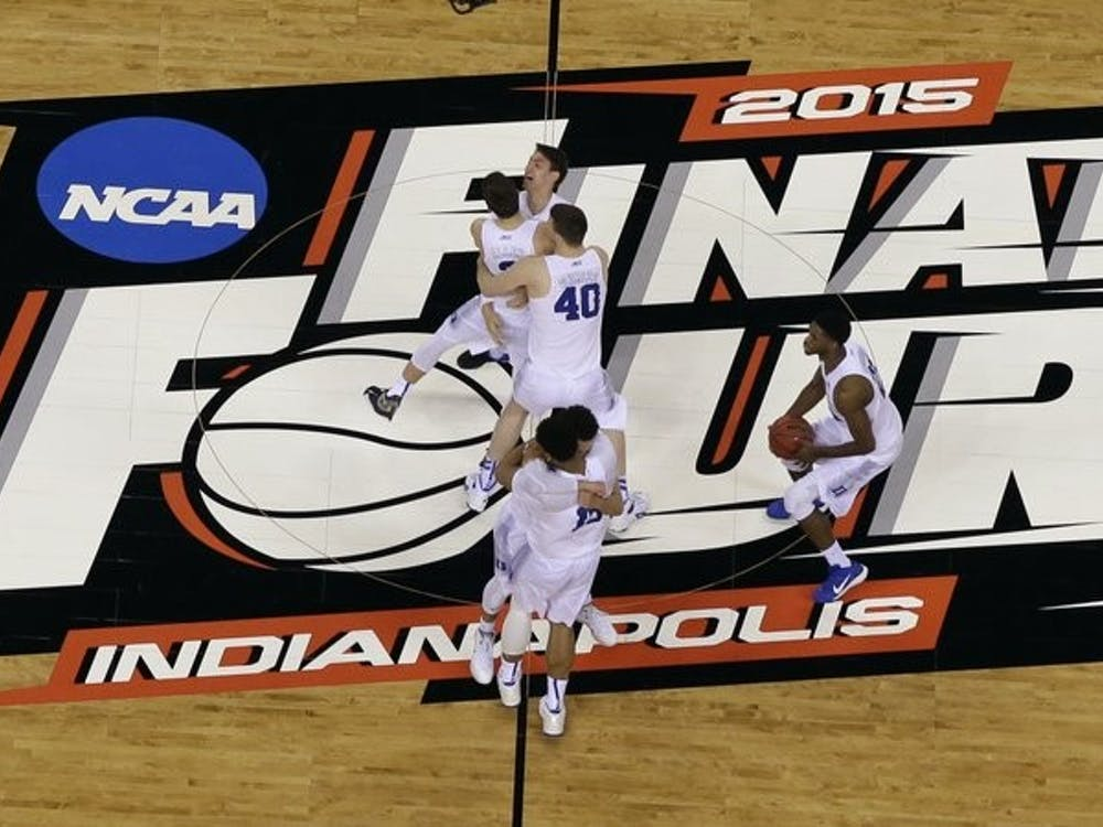 FILE - Duke players celebrate after the NCAA Final Four college basketball tournament game against Wisconsin in Indianapolis, in this Monday, April 6, 2015, file photo. The NCAA announced Monday, Nov. 16, 2020, it plans to hold the entire 2021 men's college basketball tournament in one geographic location to mitigate the risks of COVID-19 and is in talks with Indianapolis to be the host city (AP Photo/David J. Phillip, File)