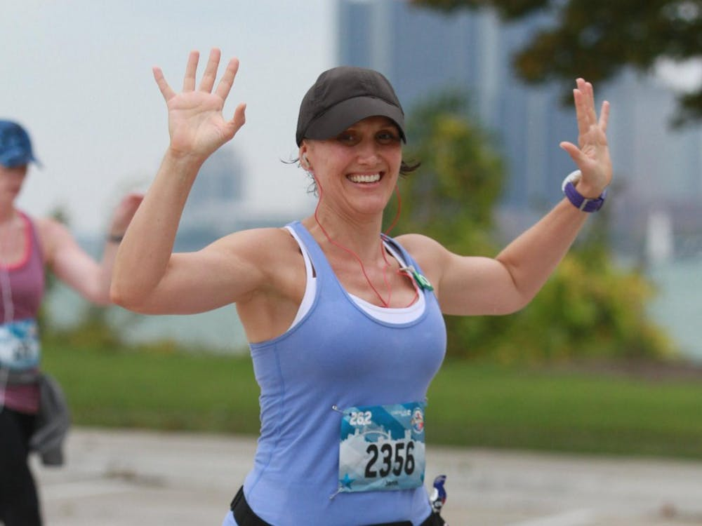 Ball State alumna Jennifer Courtney races in the 2017 Detroit Marathon. Courtney has participated in 19 marathons and will be running another in Paris on April 8. Jennifer Courtney, Photo Provided