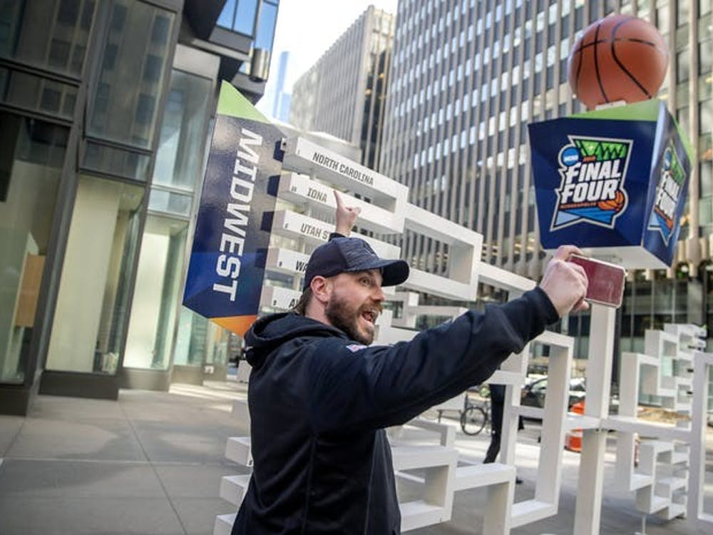 Brad Hardin took a selfie as he found his favorite team, North Carolina, on a 3-D sculpture of the Final Four bracket on the Nicollet Mall just outside the IDS Tower. (Star Tribune/TNS)