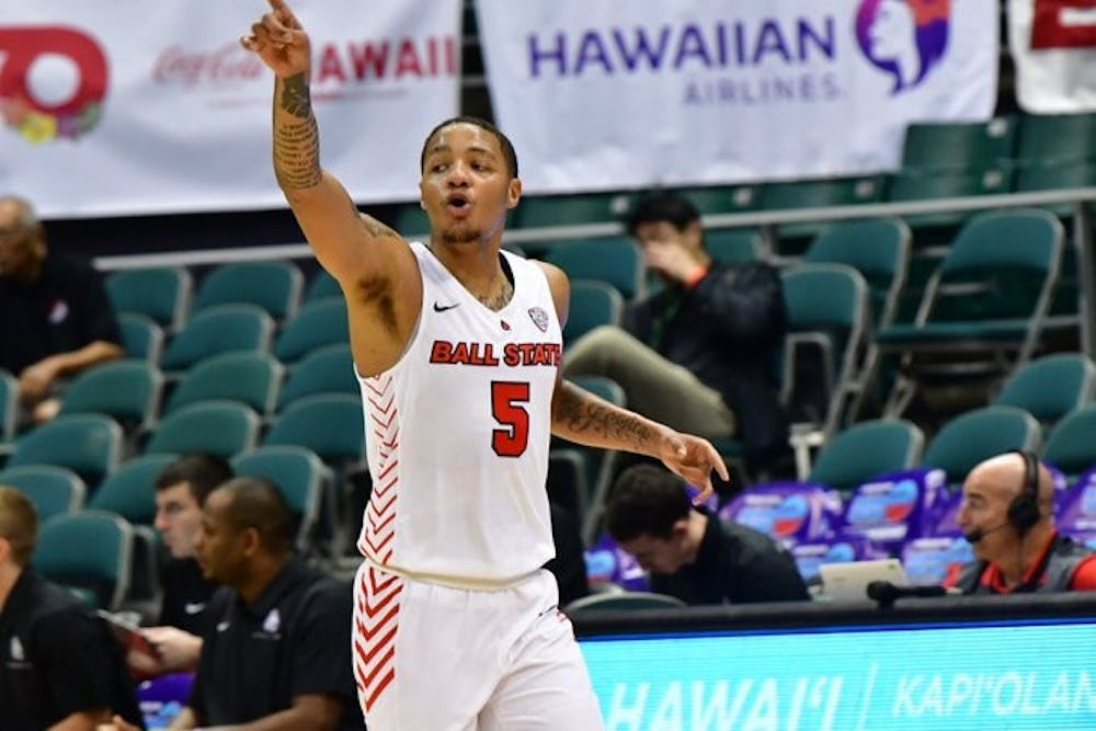 <p>Junior guard Ishmael El-Amin calls out who he's defending in a game against Portland on Dec. 25 in Honolulu, Hawaii at the Diamond Head Classic. The Cardinals defeated the Pilots, 61-46.<strong> Ball State Athletics, photo provided</strong></p>