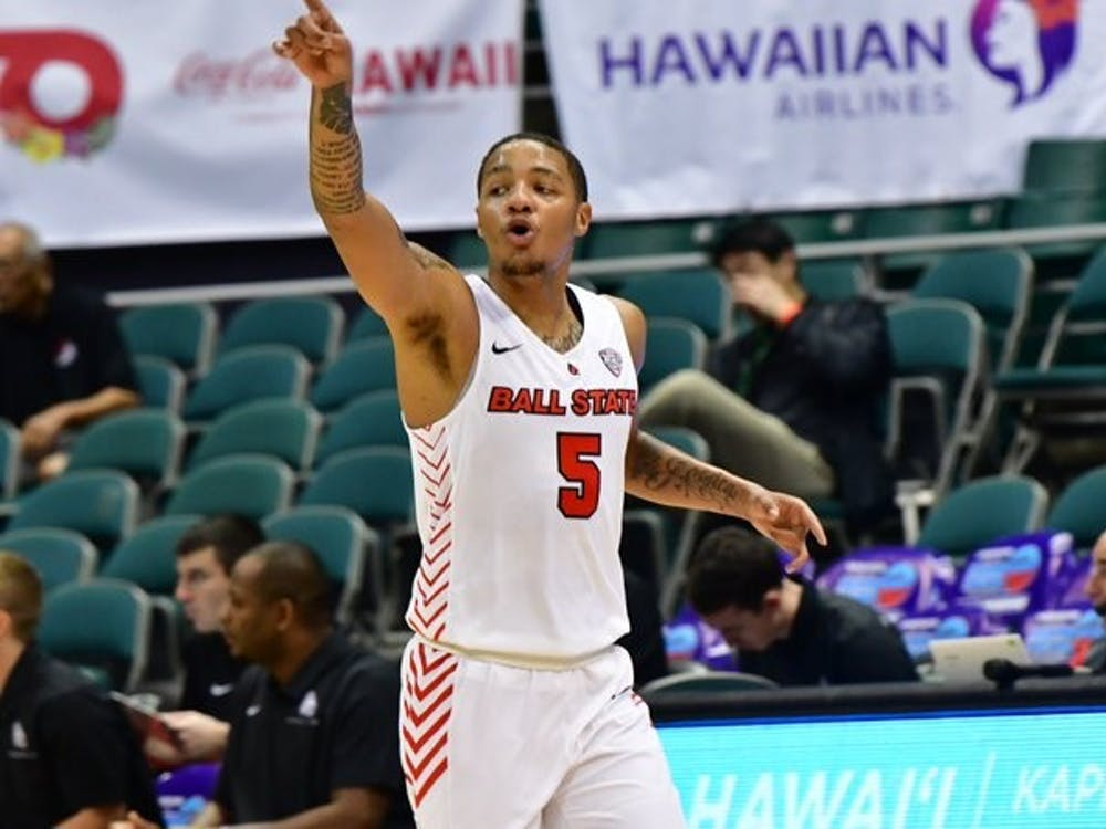 Junior guard Ishmael El-Amin calls out who he's defending in a game against Portland on Dec. 25 in Honolulu, Hawaii at the Diamond Head Classic. The Cardinals defeated the Pilots, 61-46. Ball State Athletics, photo provided