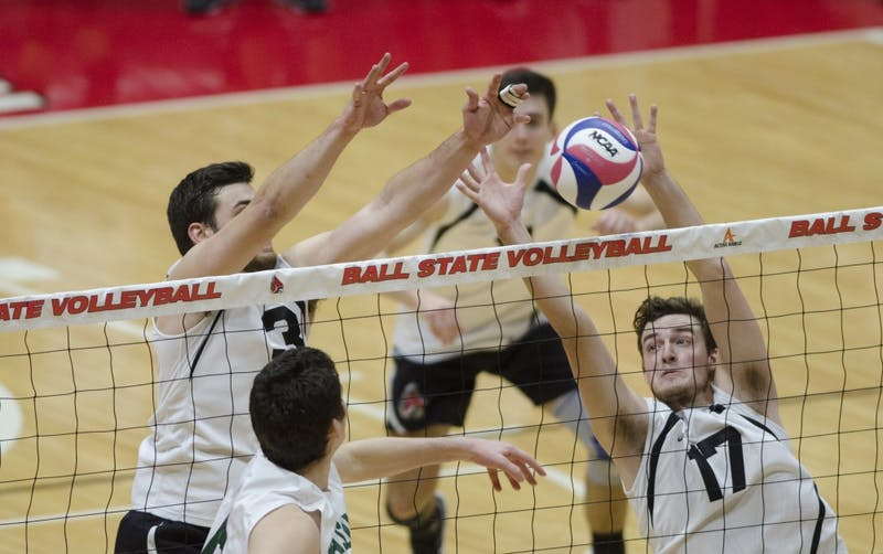 Setter Connor Gross and middle attacker Alex Pia attempt to block a hit against George Mason University on Jan. 26. Ball State won the match 3-1, improving their record to 7-1. Emma Rogers // DN