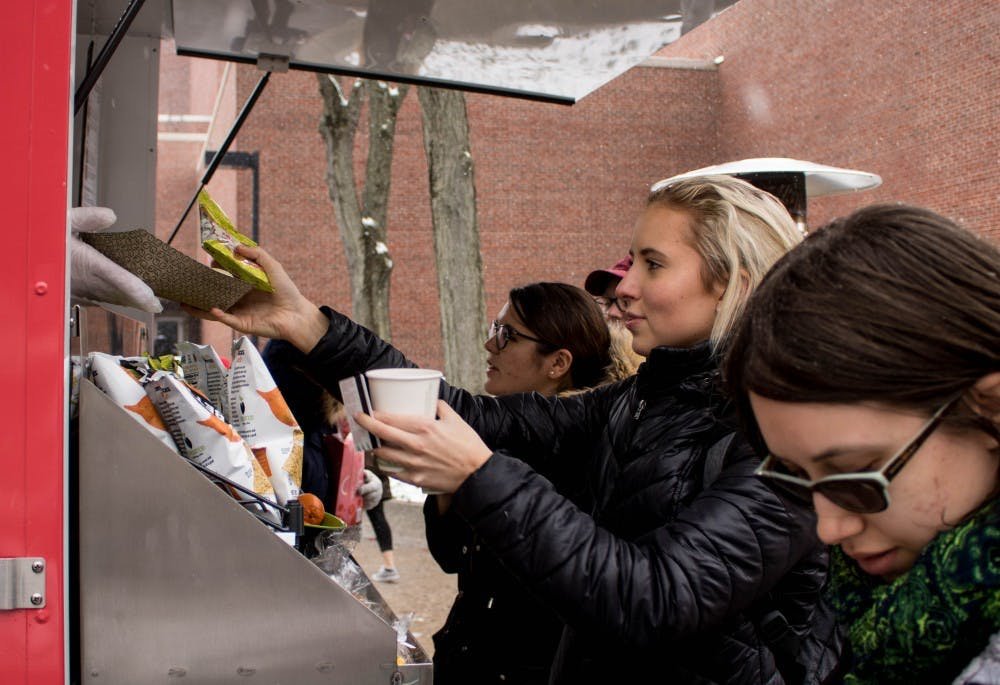 <p>A Ball State student receives their food from the food truck on campus on March 13. The food truck is open Monday through Friday from 11:30a.m. to 1:30p.m. <strong>Rebecca Slezak, DN</strong></p>