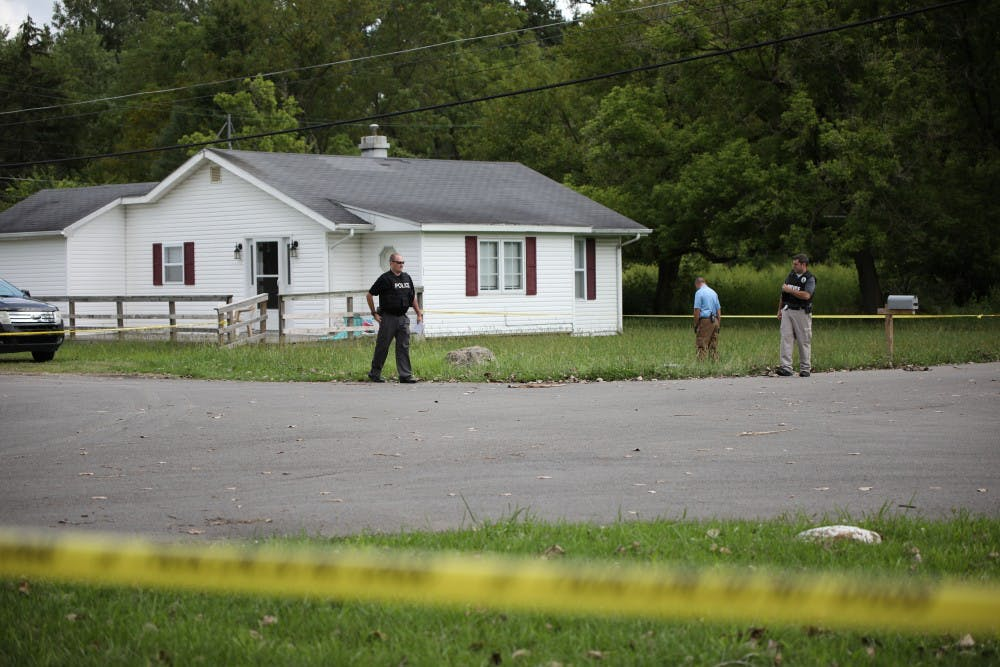 Muncie Police Department officers review the scene after a shooting at the intersection of Hartford and Princeton Street Friday, Aug. 23, 2019. Rebecca Slezak, DN