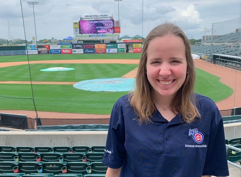 Sarah Kendall, senior sports administration major, poses for a photo at Principal Park in Des Moines, Iowa. Kendall is spending her summer with the Minor League Baseball team Iowa Cubs as a stadium operations intern. Sarah Kendall, Photo Provided