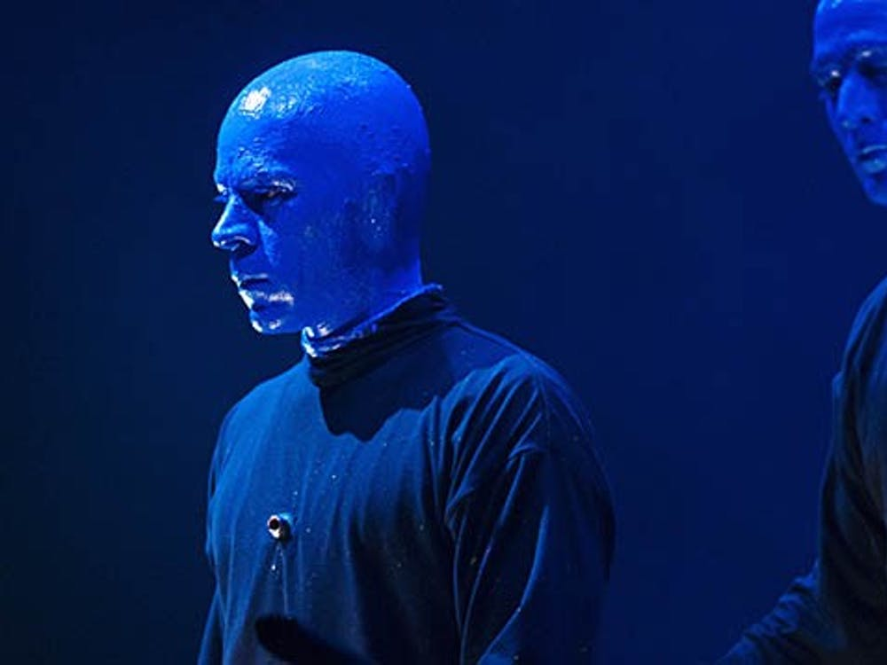 Blue Man Q&A - Russell Rinker of the Blue Man Group looks out on the audience in John R. Emens Auditorium during a break in the music on Tuesday. Rinker has been an off-and-on member of the show for 10 years. This is his first national tour. DN FILE PHOTO BOBBY ELLIS