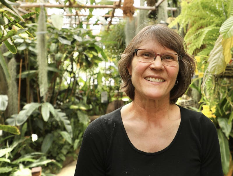 Greenhouse Curator Cheryl LeBlanc poses for a photo April 23, 2021, in the Rinard Orchid Greenhouse. LeBlanc curates the largest university-based orchid collection in the country. Rylan Capper, DN