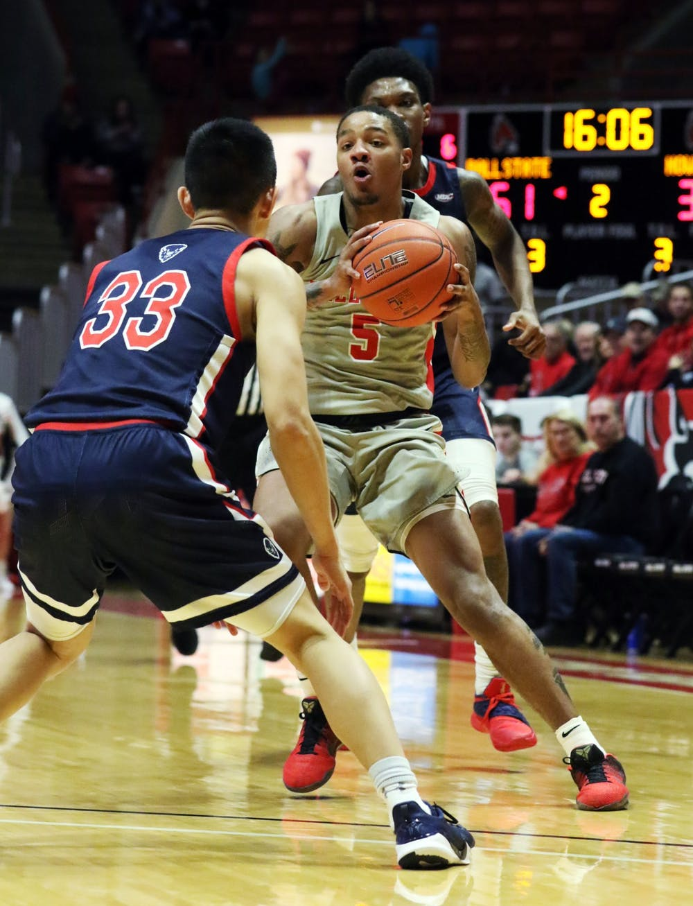 <p>Ball State junior guard Ishmael El-Amin moves the ball in while being guarded by Howard freshman guard Ian Lee during the Cardinals' game against the Bison Saturday, Nov. 23, 2019, at John E. Worthen Arena. Ball State won 100-69. <strong>Paige Grider, DN</strong></p>