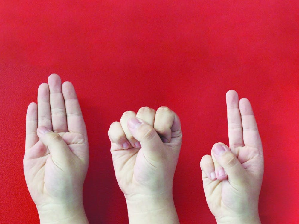 """Three hands sign the letters """"B,"""" """"S"""" and """"U."""" American Sign Language is now a class that can fulfill Ball State's modern language requirement. JACOB MUSSELMAN, DN ILLUSTRATION"""