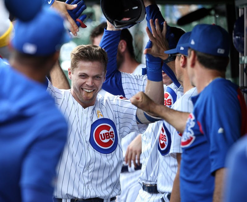 Chicago Cubs shortstop Nico Hoerner (2) is congratulated after hitting a home run in the first inning against the Pittsburgh Pirates on Friday, Sept. 13, 2019 at Wrigley Field in Chicago, Ill. (Terrence Antonio James/Chicago Tribune/TNS)