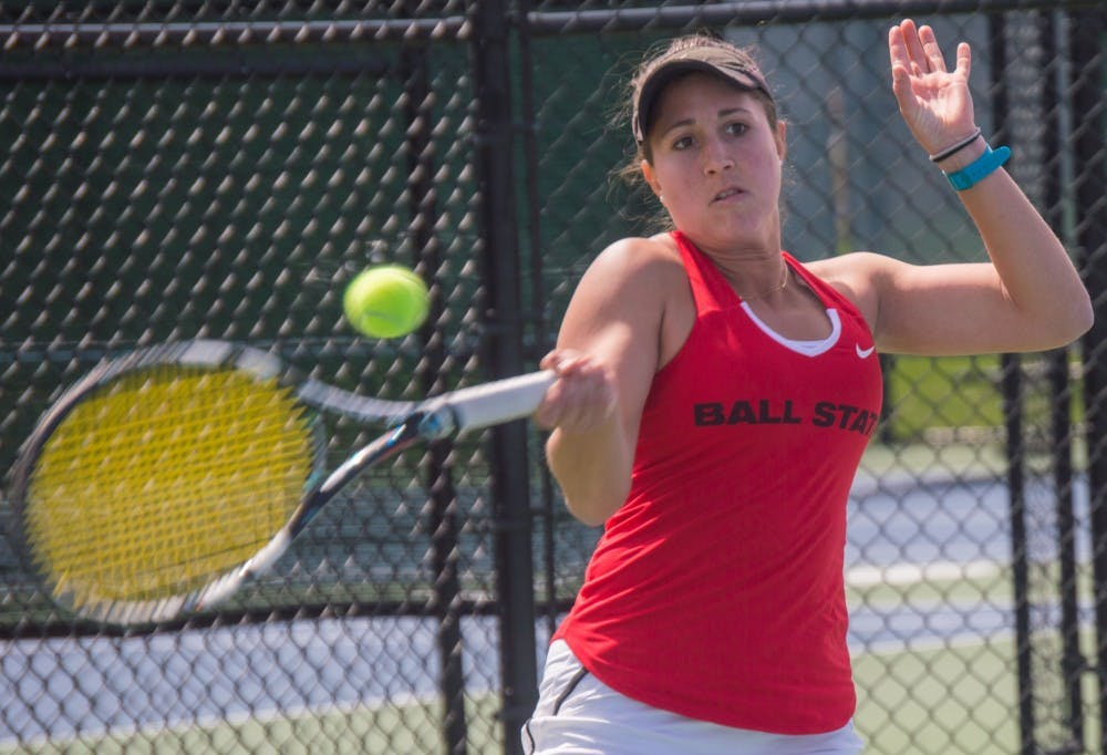 <p>Senior Carmen Blanco hits the ball to the other side of the court during the match against Buffalo on April 2 at the Cardinal Creek Tennis Center. Blanco won her match 2-0. <strong>Terence K. Lightning Jr., DN</strong></p>