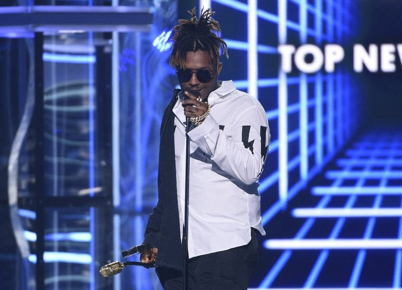 In this May 1, 2019 file photo, Juice WRLD accepts the award for top new artist at the Billboard Music Awards at the MGM Grand Garden Arena in Las Vegas. Chicago police said they're conducting an investigation into the rapper's death after a medical emergency Dec. 8, 2019, at Chicago's Midway International Airport. (Photo by Chris Pizzello/Invision/AP File)