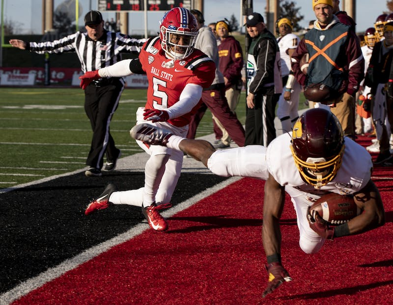 Central Michigan's Kalil Pimpleton runs the ball off the field to avoid a tackle from Ball State junior safety Bryce Cosby Nov. 16, 2019, at Scheumann Stadium. Cosby finished the game with five tackles and two pass breakups. Rebecca Slezak, DN