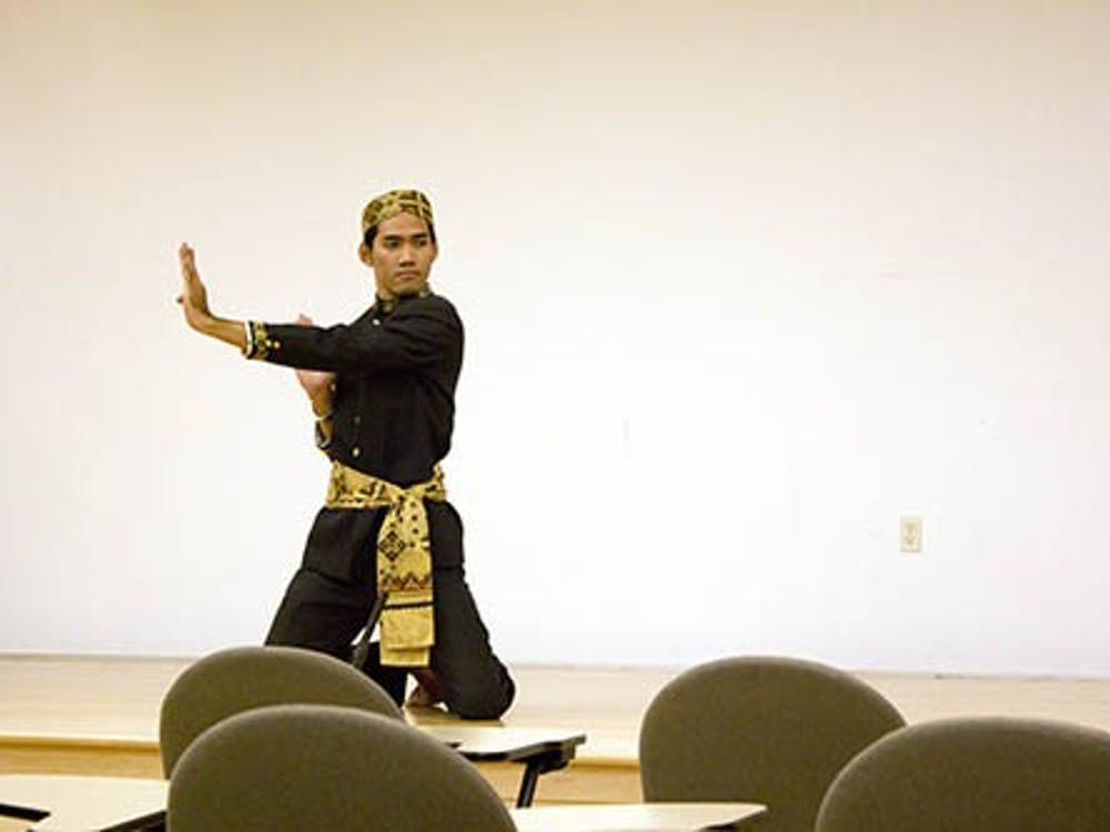 Zacky Anderson, an English literature major from Jakarta, Indonesia, performs a dance native from his country. The dance was part of the Study of the U.S. Institute program. DN PHOTO ROSS MAY
