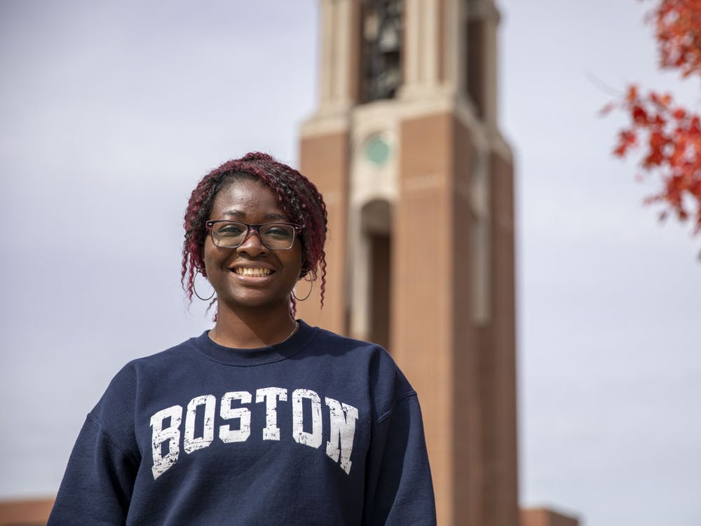 Emerging media and design graduate student Deborah Ojo poses in front of Shafer Tower Oct. 14, 2020, at University Green. Ojo works as a mentor for student-athletes and said she has had to work harder to make sure students get homework done in a virtual atmosphere. Jacob Musselman, DN