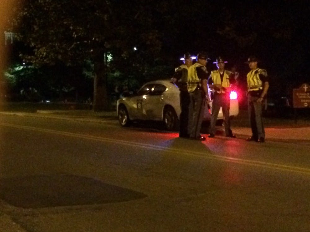 State police stop cars on New York Ave. near campus looking for drunk drivers. The checkpoint was part of the state's Drive Sober or Get Pulled Over campaign that ends after Labor Day weekend. DN PHOTO CHRISTOPHER STEPHENS