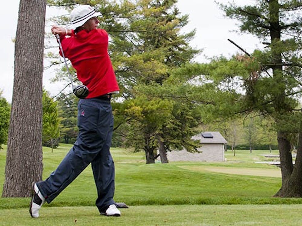 Tyler Merkel takes a swing at the Earl Yestingsmeier Invitational in Muncie on April 21, 2012. Merkel finished three rounds with a score of 214 at the Pinehurst Intercollegiate tournament March 10 to 12, 2013. Ball State won with a score of 885. DN FILE PHOTO BOBBY ELLIS