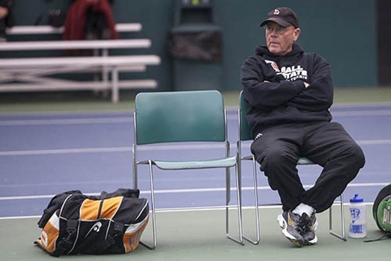 Head coach Bill Richards watched a match between his players and IPFW on Wednesday afternoon. Richards has been the head coach of the tennis team for 36 seasons. DN PHOTO JORDAN HUFFER