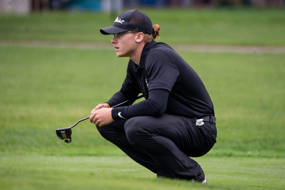 <p>Junior Sterling McIlravy squats down to look at the green Sept. 9, 2019. Mcllravy played two seasons of collegiate golf at two different junior colleges before coming to Ball State. <strong>Kirkwood Community College Athletics, Photo Provided</strong></p>