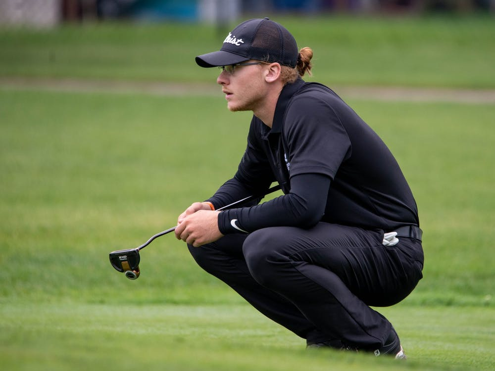 Junior Sterling McIlravy squats down to look at the green Sept. 9, 2019. Mcllravy played two seasons of collegiate golf at two different junior colleges before coming to Ball State. Kirkwood Community College Athletics, Photo Provided