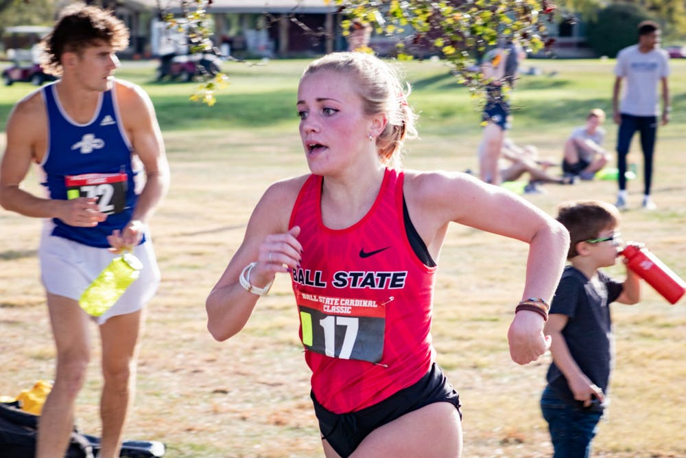 <p>Ball State junior Cayla Eckenroth sprints to the finish first Oct. 18, 2019, at the Elks Country Club in Muncie. Eckenroth was followed by five other Ball State runners in the event. <strong>Eric Pritchett, DN</strong></p>