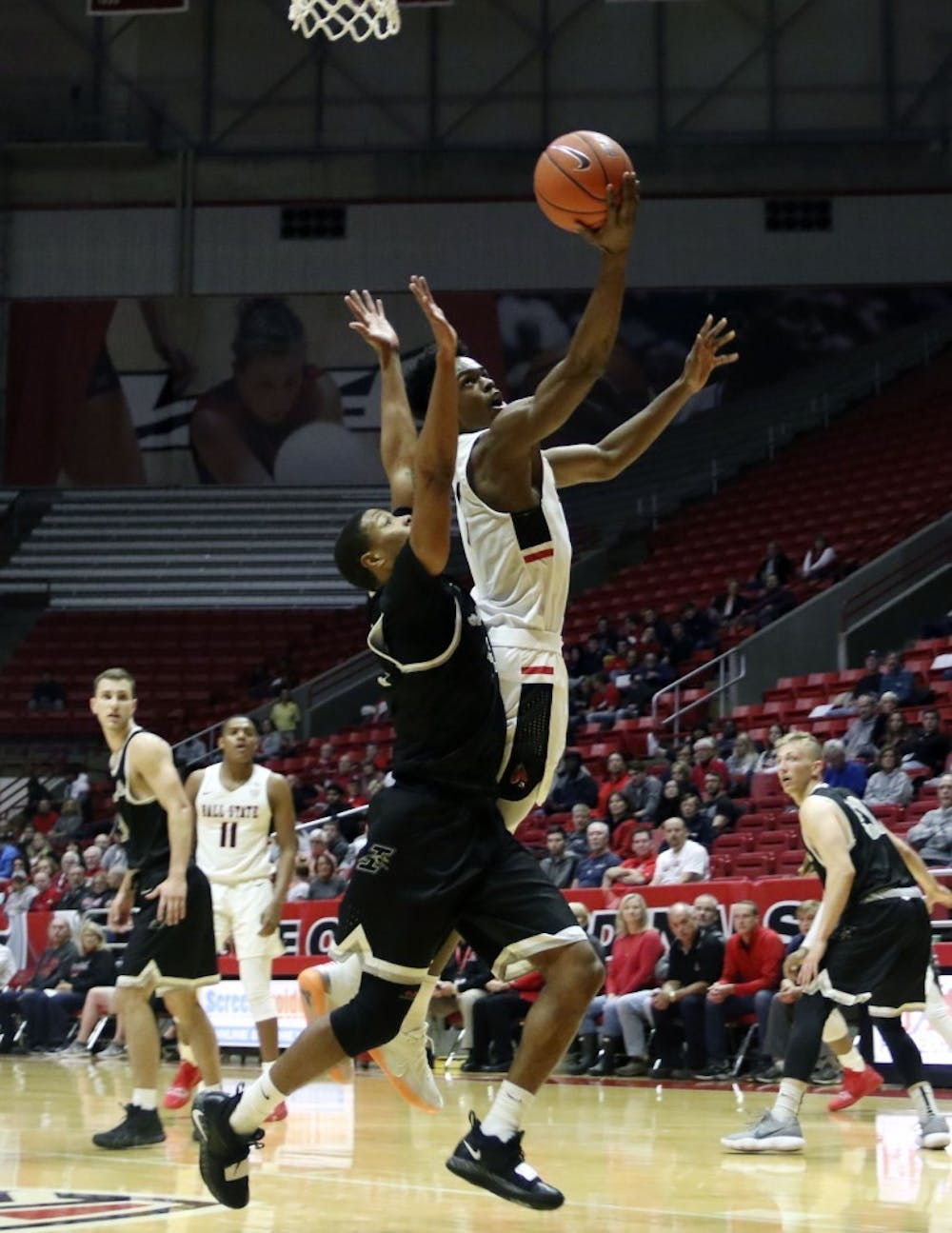 <p>Ball State redshirt junior guard K.J. Walton goes for a layup while being guarded by the University of Indianapolis' CJ Hardaway during the Cardinals' exhibition game against the Greyhounds Nov. 2, 2018, in John E. Worthen Arena. Walton scored 15 points. <strong>Paige Grider, DN</strong></p>