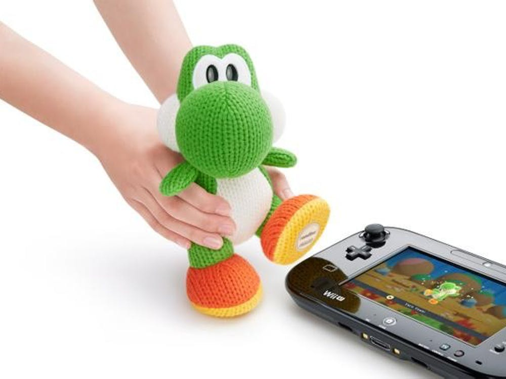 Users will be able to scan Mega Yarn Yoshi's foot in order to gain a power-up in Yoshi's Wooly World