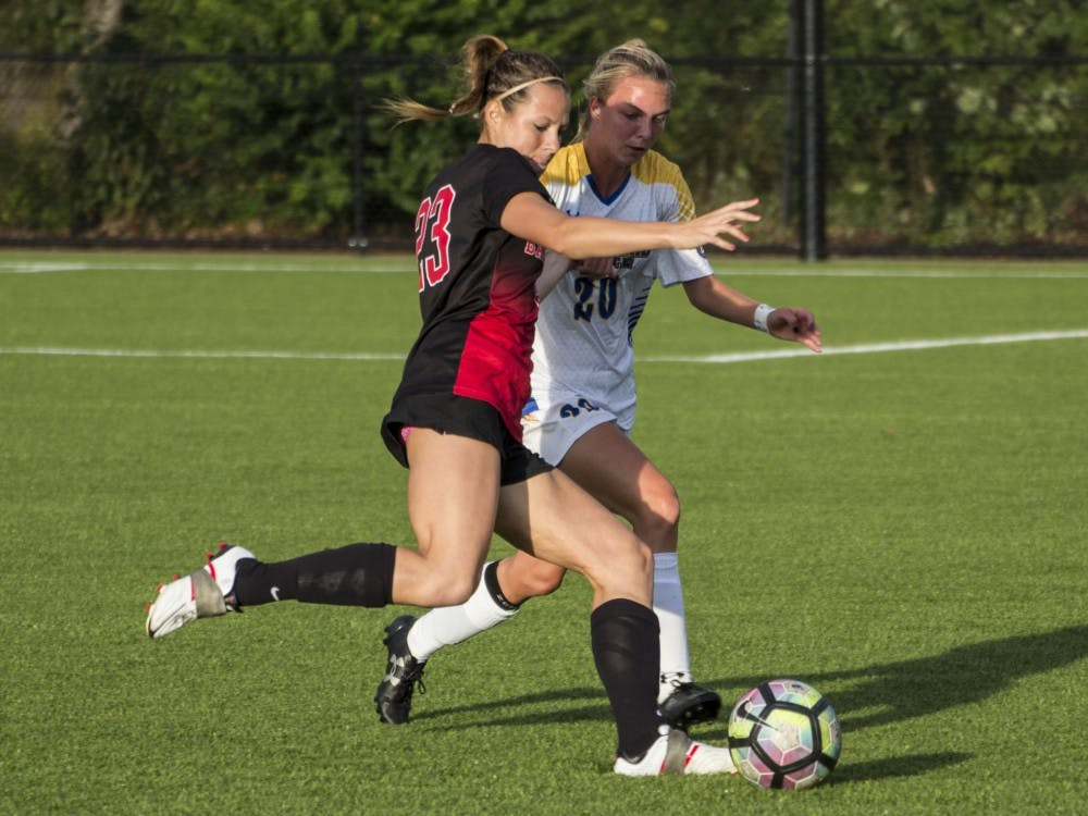 Ball State forward Sam Kambol protects the ball from Morehead State's midfielder Haley Best during the game on Sept. 16 at the Briner Sports Complex. Ball State won 4-0. Grace Ramey // DN