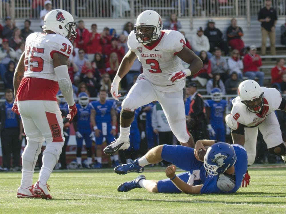 Senior defensive end Nick Miles celebrates after sacking the Indiana State quarterback during the game on Sept. 13 at Scheumann Stadium. DN PHOTO BREANNA DAUGHERTY