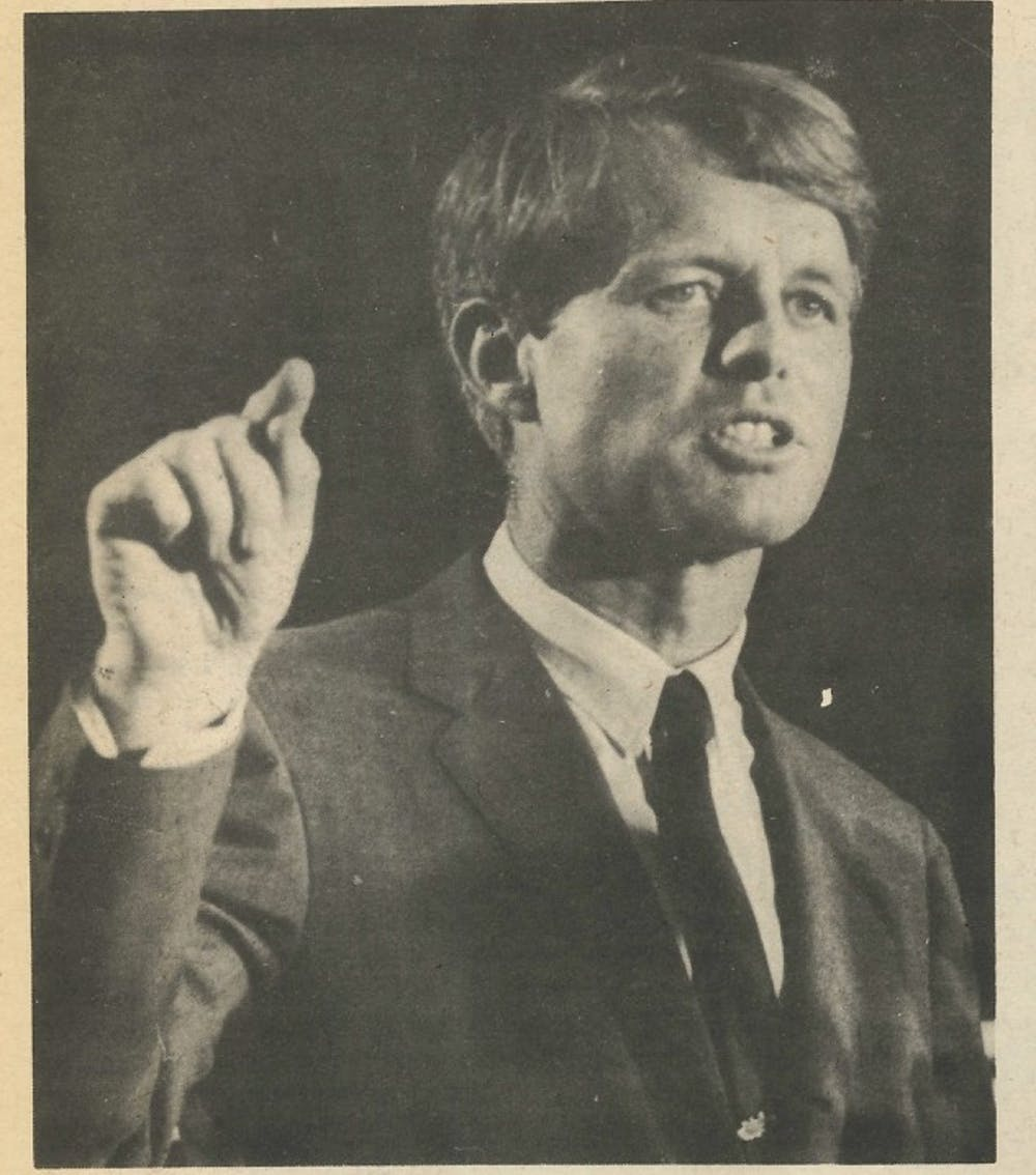 """<p>Kennedy was given an """"enthusiastic"""" reception when he arrived in Muncie April 4, 1968. During his speech, he called for the United States to face responsibilities for actions taken during the Vietnam War, and he also opened the floor for a short question-and-answer session with the audience. In May 1968, Kennedy won the Indiana primary with 42 percent of the vote. This photo was published in the May 9, 1968 edition of The Ball State News.</p>"""