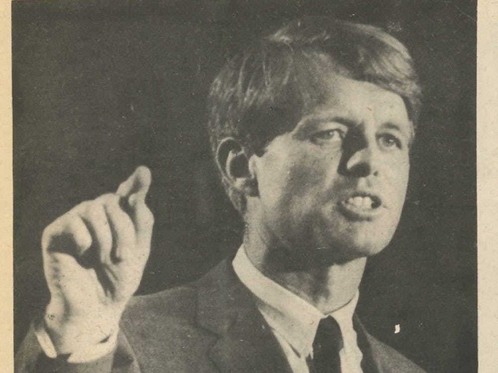 """Kennedy was given an """"enthusiastic"""" reception when he arrived in Muncie April 4, 1968. During his speech, he called for the United States to face responsibilities for actions taken during the Vietnam War, and he also opened the floor for a short question-and-answer session with the audience. In May 1968, Kennedy won the Indiana primary with 42 percent of the vote. This photo was published in the May 9, 1968 edition of The Ball State News."""