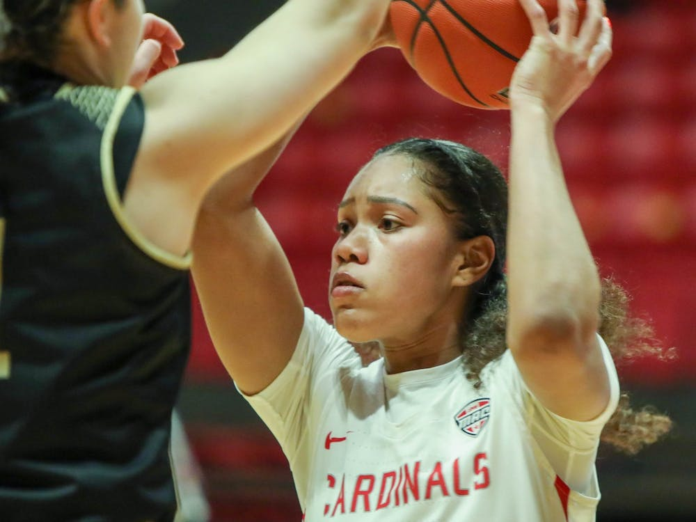 Senior forward Oshlynn Brown passes the ball March 6, 2021, in John E. Worthen Arena. The Cardinals beat the Broncos 76-69. Jaden Whiteman, DN