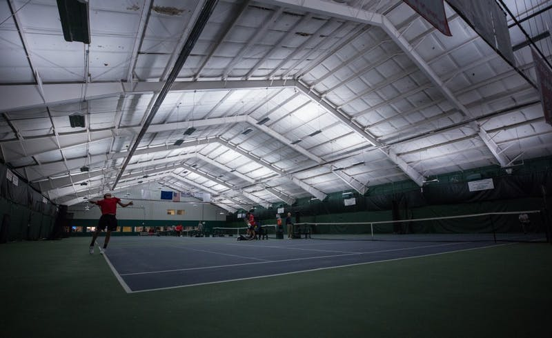 Ball State's mens tennis plays singles matches against the University of Toledo. Ball State won 5 to 2 on March 24 at Northwest YMCA in Muncie. Eric Pritchett, DN