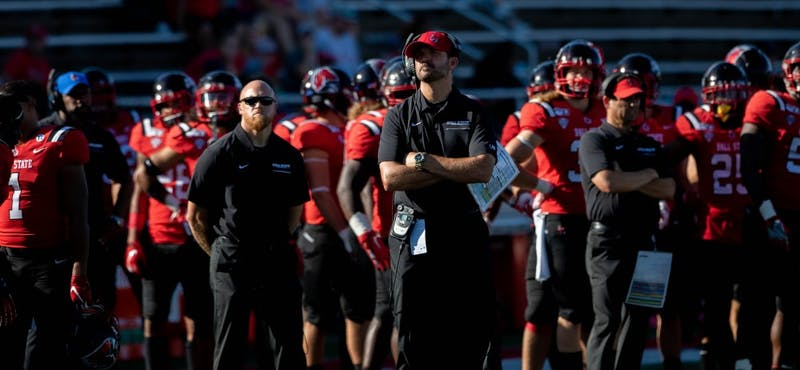 Ball State Football head coach Mike Neu and his team watch the jumbotron in a game against Florida Atlantic at Scheumann Stadium Sept. 14, 2019. The Cardinals lost to the Owls, 41-31. Jacob Musselman, DN