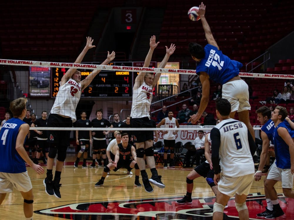 Junior Jake Romano and senior Parker Swartz jump to block a spike by Freshman Amador Sow, Jan. 18, 2019 at John E. Worthen Arena. Ball State lost to Santa Barbara 2-3. Rebecca Slezak,DN