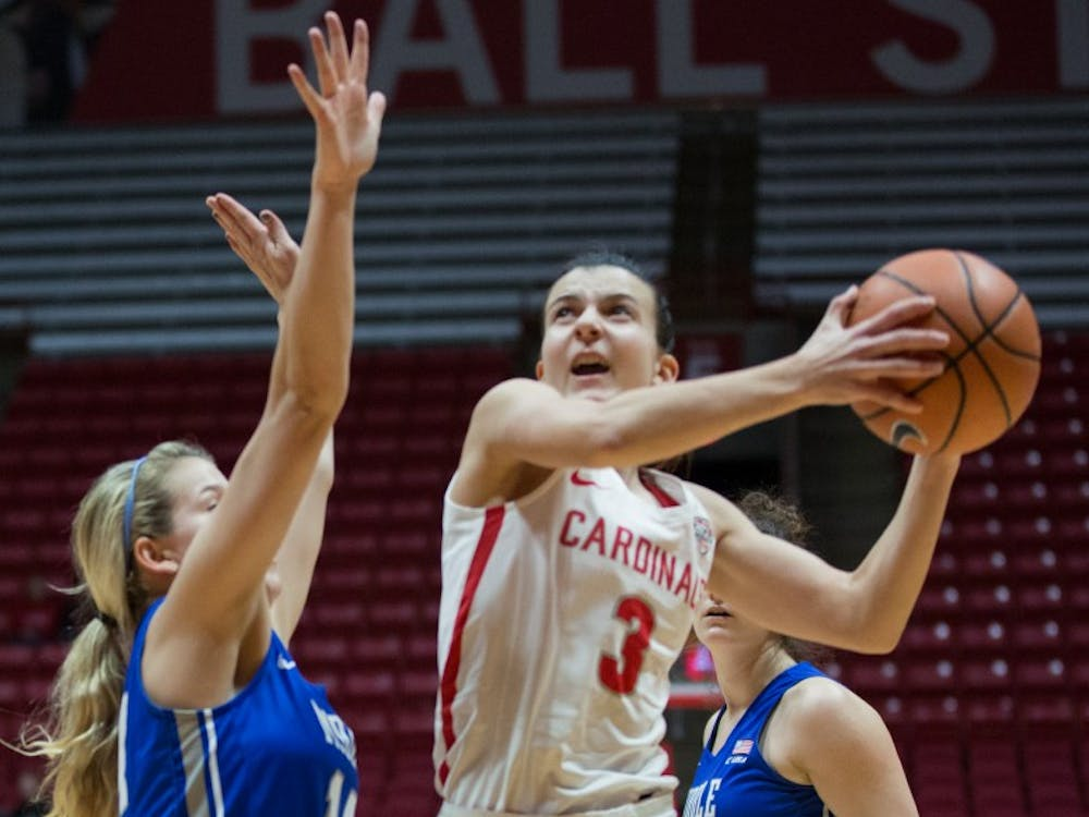 Junior guard Carmen Grande goes for a lay-up in the game March 15 against Middle Tennessee in John E. Worthen Arena. Eric Pritchett, DN