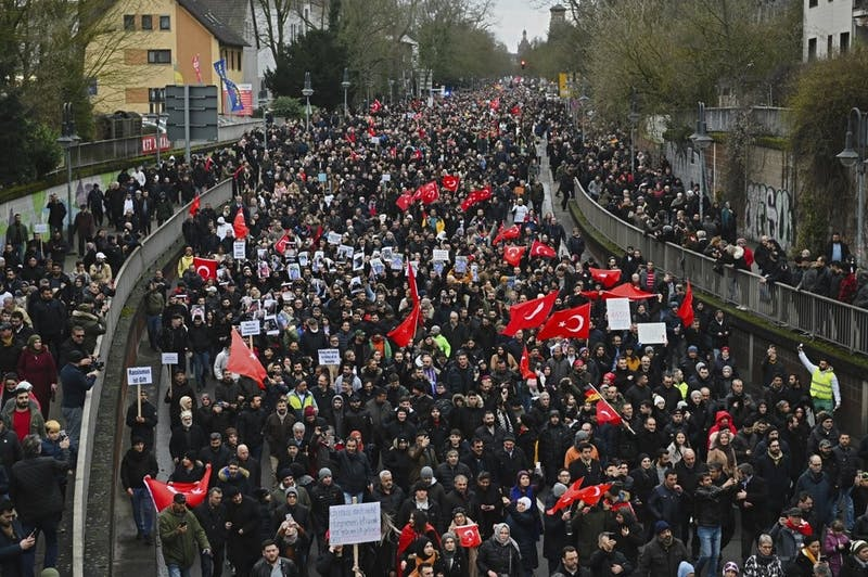 Thousands of people take part in a funeral march Feb. 23, 2020, in Hanau, Germany. Several people were killed in a shooting in the central German city Feb. 19, 2020. (Nicolas Armer/dpa via AP)