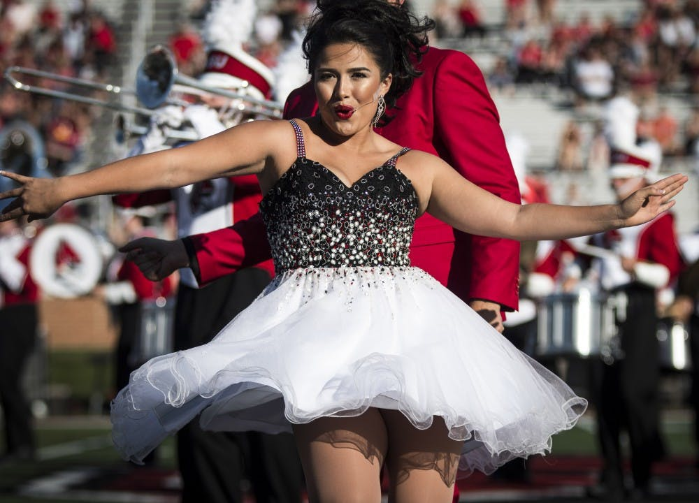 A member of University Singers performs duirng the halftime show with the Pride of Mid-America marching band, Oct. 21 at Scheumann Stadium during the Homecoming football game against Central Michigan. Ball State lost to Central Michigan, 9-56. Grace Hollars, DN