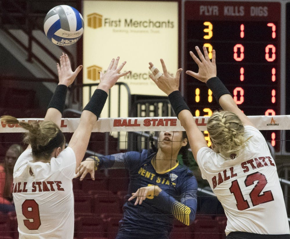 <p>Ball State blocks a spike from Kent State at the game on Oct. 14, 2016.&nbsp;</p>