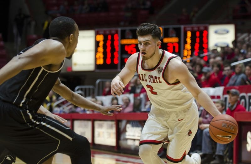 Sophomore guard Tayler Persons looks to pass the ball during the game against Northern Illinois University on March 3. Ball State won the game 87-82, making them the co-champion of the Mid-American Conference West Division. Emma Rogers, DN File