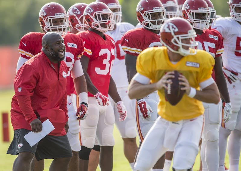 Kansas City Chiefs running backs coach Eric Bieniemy shouted during drills between runnings backs and linebackers on Monday, Aug. 4, 2014 during Kansas City Chiefs summer training camp practice at Missouri Western State University in St. Joseph, Mo. (David Eulitt/Kansas City Star/MCT/TNS)