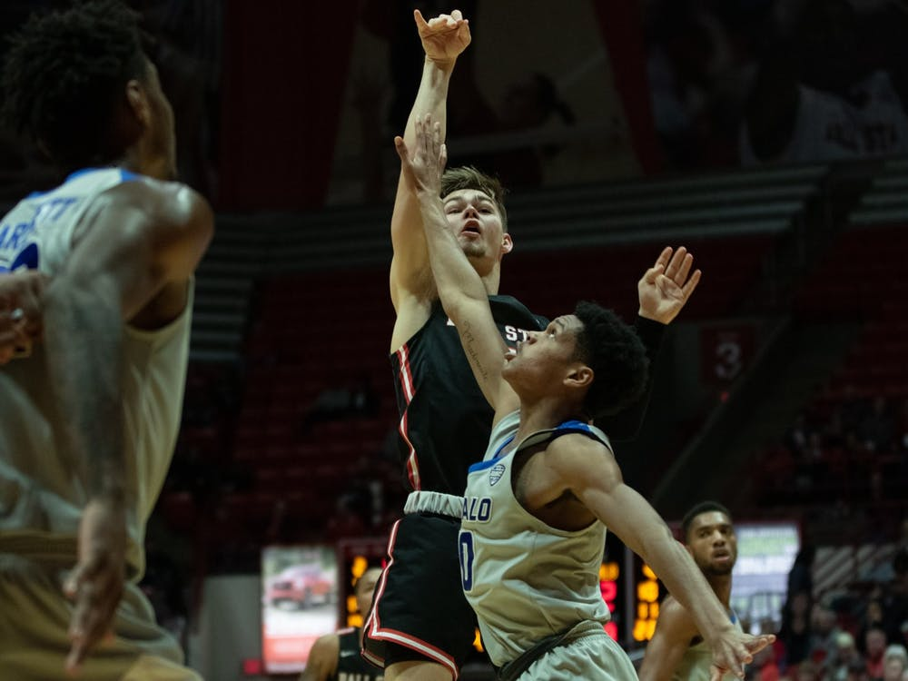 Freshman Luke Bumbalough scores a three pointer against the Buffalo Bulls Jan. 7, 2020, at John E. Worthen Arena. Bumbalough scored nine points against the Bulls. Jacob Musselman, DN